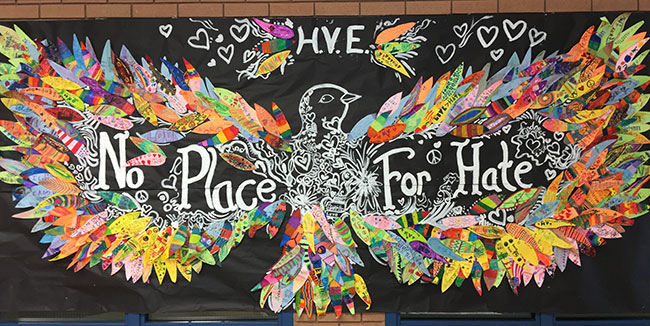 what happens when two teachers put their heads together to come up with a bullying prevention project for their students more than 550 paper feathers