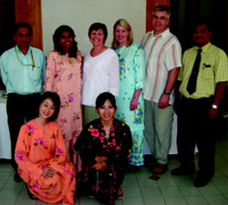Sue Folger posing with families of children with disabilities in Malaysia