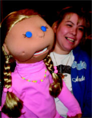 Visitor from England bonds with puppet Sally